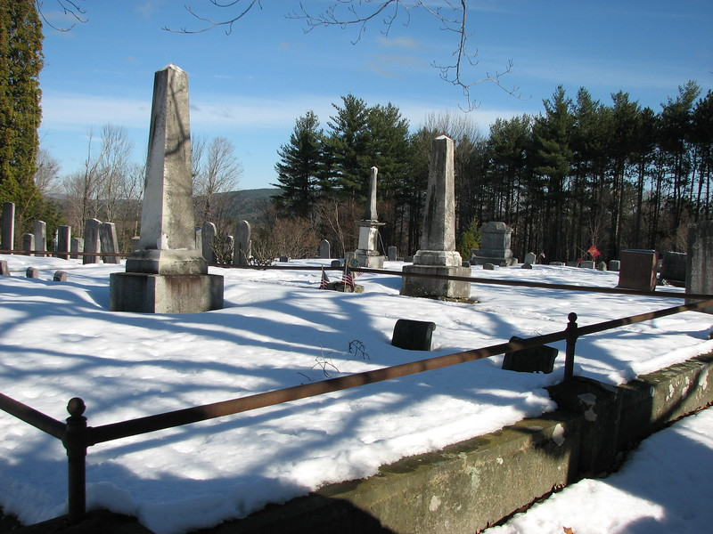 This is the view just inside the gate, looking diagonally to the right. Note the three obelisks in view. The one to Dr. Chadwick is the middle, most distant one. If you enter the cemetery and walk straight in along the central pathway for about 44 feet, then turn right and walk about 50 feet, you will come to the monument.