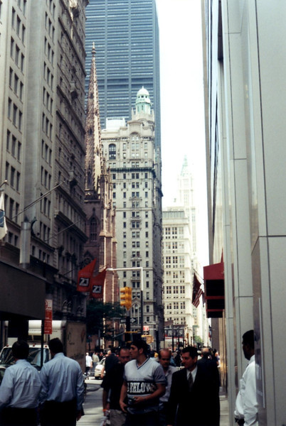 A view up Broadway. Look carefully for the spire of Trinity Church on the left. The church is dwarfed by today's modern structures.