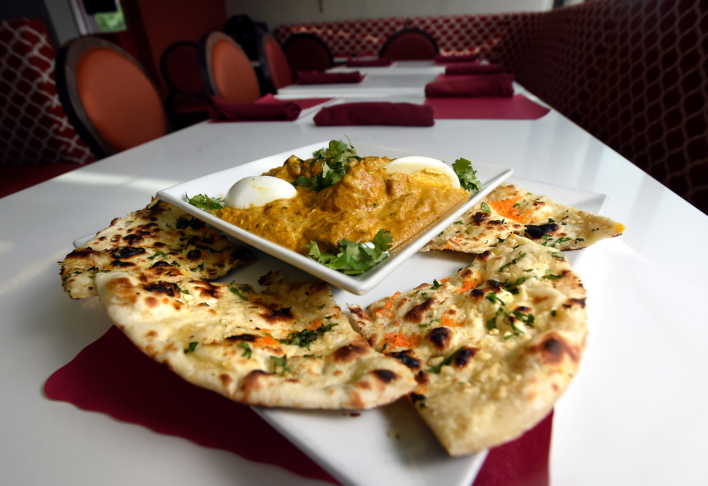 . Chicken Mugulai and garlic naan with garlic cream sauce, coriander and egg at Bawarchi Birayni\'s Indian Resturaunt on Tuesday in Louisville. For more photos of the food go to dailycamera.com Jeremy Papasso/ Staff Photographer 07/03/2018