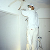 Fixing cracks in plaster and repainting, circa 1999.