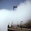 Golden Gate Bridge rising from fog