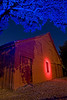 Ambient light was provided by a parking lot light. <br /> Spot light with red gel to highlight the window.<br /> <br /> Popped my strobe with blue gel filter on the <br /> tree branches and leaves.<br /> <br /> From experimentation, it seems that a 60 second exposure<br /> at f5.6, ISO 200 is about right for ambient light created <br /> by a street light.