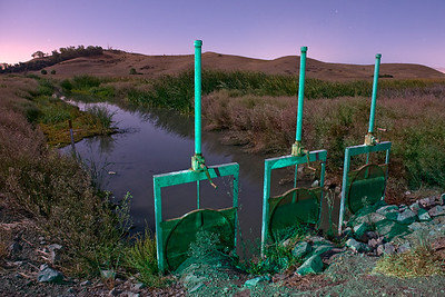 Creek Flood Control Gates, Coyote Hills, Fremont, CA  3 pops of the strobe with green gel popped low to the ground from the left.