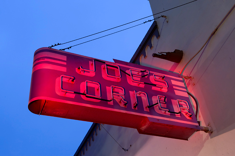 Joe's Corner Sign, Niles, Fremont, CA<br /> <br /> First attempt at light painting.  Taken in the early morning.<br /> The morning was dark, but there was a lot of ambient light from<br /> street lights.<br /> <br /> I used a portable spot light with a red gel filter and painted<br /> the sign.<br /> <br /> I didn't know what I was doing really, it was more trial and error.<br /> <br /> I heard that Joe's Corner may be revived in the future as a coffee<br /> house.