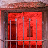Early morning shot of the iron bars of Battery Kirby.<br /> <br /> Interior lit with multiple pops of the strobe<br /> with red gel.