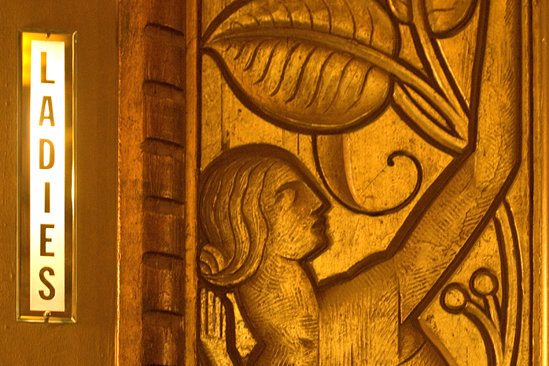 Ladies room sign and bas-relief wall