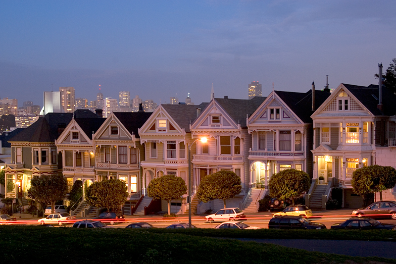The Six Sisters (aka Painted Ladies), plus a step sister at the lower end.<br /> <br /> I'd like to reshoot this on a different evening, from higher up on the hill.<br /> <br /> A higher location will block out the row of cars parked on the street and <br /> expand the background view of the city skyline.<br /> <br /> So many people take this photo, there are circular dead spots on the grass from <br /> overuse by photographers and sightseers.  <br /> <br /> Nonetheless, I like having my own shot.
