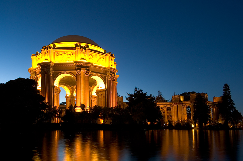 Palace of Fine Arts, San Francisco, CA<br /> <br /> Shot with a wide angle lens (Nikon 12-24mm, f4) at 18mm, f5 for 9 seconds.<br /> Aperture priority and matrix metering.  <br /> <br /> As with all low light photography, I mounted the camera on a tripod, used a cable <br /> release and mirror lockup.<br /> <br /> Bracketed the shots and chose the exposure that I like the best.  <br /> <br /> Adjusted the white balance with Adobe Camera Raw processor to 4600K. <br /> <br /> Shot during the blue hour.