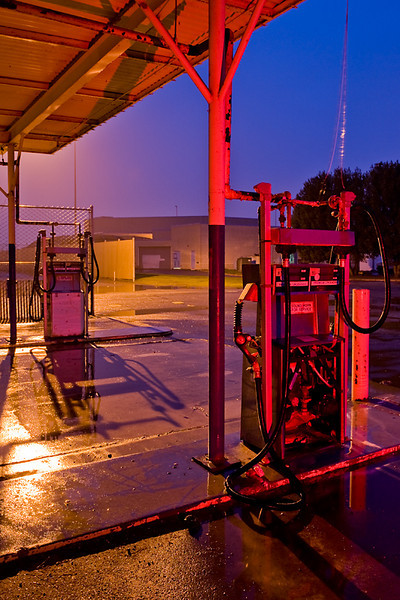 Remnants of a gasoline station, Treasure Island,<br /> San Francisco, CA<br /> <br /> Shot on a showery evening, the roof of the <br /> gas station provided cover.  <br /> <br /> Back lit by a street light, front lit with a <br /> red gel strobe.