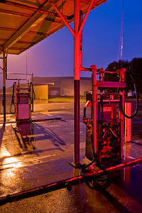Remnants of a gasoline station, Treasure Island, San Francisco, CA  Shot on a showery evening, the roof of the  gas station provided cover.    Back lit by a street light, front lit with a  red gel strobe.
