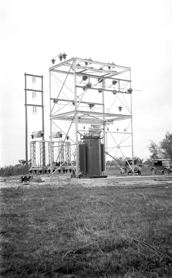 Building the first electric substation. Circa 1923.