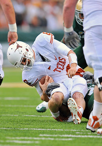 03 Dec 2011:   Texas Longhorns quarterback Case McCoy (6) is sacked and rolls his ankle during the game between the Texas Longhorns and the Baylor Bears at Floyd Casey Stadium in Waco Texas. Baylor wins 48-24 Manny Flores/CSM(Credit Image: © Manny Flores/Cal Sport Media/ZUMAPRESS.com)