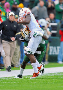 03 Dec 2011:   Texas Longhorns running back Foswhitt Whittaker (2) runs outside as he is tackled hard by Baylor Bears safety K.J. Morton (8) during the game between the Texas Longhorns and the Baylor Bears at Floyd Casey Stadium in Waco Texas. Baylor wins 48-24 Manny Flores/CSM(Credit Image: © Manny Flores/Cal Sport Media/ZUMAPRESS.com)
