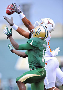 03 Dec 2011:   Texas Longhorns cornerback Adrian Phillips (17) tries to INT the ball from Baylor Bears wide receiver Kendall Wright (1) during the game between the Texas Longhorns and the Baylor Bears at Floyd Casey Stadium in Waco Texas. Baylor wins 48-24 Manny Flores/CSM(Credit Image: © Manny Flores/Cal Sport Media/ZUMAPRESS.com)