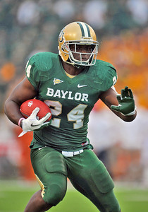 03 Dec 2011:   Baylor Bears running back Terrance Ganaway (24) carries the ball for a first down during the game between the Texas Longhorns and the Baylor Bears at Floyd Casey Stadium in Waco Texas. Baylor wins 48-24 Manny Flores/CSM(Credit Image: © Manny Flores/Cal Sport Media/ZUMAPRESS.com)