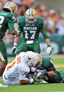 03 Dec 2011:   Texas Longhorns wide receiver Mike Davis (1) fumbles the ball as Baylor Bears cornerback Ahmad Dixon (6) tries to recover the ball during the game between the Texas Longhorns and the Baylor Bears at Floyd Casey Stadium in Waco Texas. Baylor wins 48-24 Manny Flores/CSM(Credit Image: © Manny Flores/Cal Sport Media/ZUMAPRESS.com)