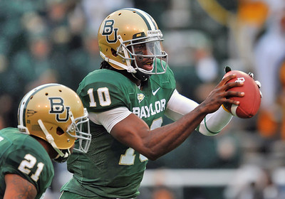 03 Dec 2011:   Baylor Bears quarterback Robert Griffin III (10) looks downfield to pass the ball during the game between the Texas Longhorns and the Baylor Bears at Floyd Casey Stadium in Waco Texas. Baylor wins 48-24 Manny Flores/CSM(Credit Image: © Manny Flores/Cal Sport Media/ZUMAPRESS.com)