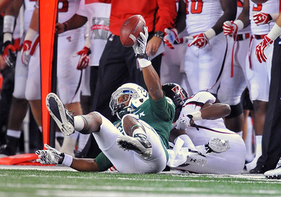 26 Nov 2011:   Baylor Bears wide receiver Lanear Sampson (3) catches the ball for a first down as he is tackled by Texas Tech Red Raiders cornerback Happiness Osunde (28) during the game between Texas Tech Red Raiders and the Baylor Bears at Cowboy Stadium in Arlington Texas. Baylor wins 66-42. Manny Flores/CSM(Credit Image: © Manny Flores/Cal Sport Media/ZUMAPRESS.com)