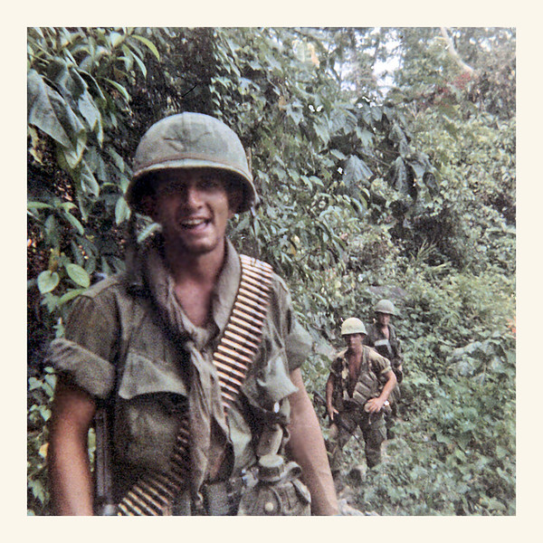 "JSRB021: Jerry ""Short-round"" Baynes, 1st Platoon, GA, likely March 1968 in the boonies with M-60 ammo; it's difficult to tell, but that might be Hacker and Shull in the background."