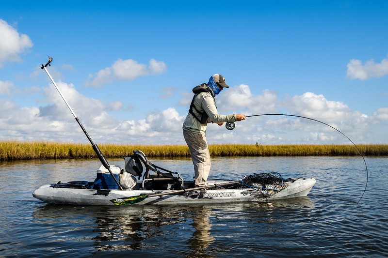 Drew Ross hooked up to a big redfish on the fly