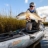 Drew Ross in his Coosa FD showing off a big redfish on the fly