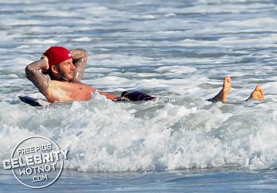 David Beckham Cops An Eyeful Of A Fellow Beachgoer In Revealing Speedos! Malibu, CA