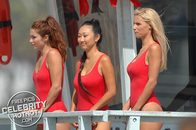 """EXCLUSIVE: Michelle Hunziker Wears Red """"Baywatch' Inspired Swimsuit Filming On Santa Monica Beach, CA"""