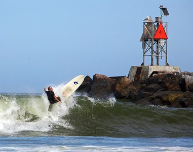 Surfer cutback jetty- this is Bill Cooke. Now on display @ the Beach Pub