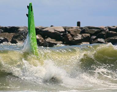 green loose surfboard
