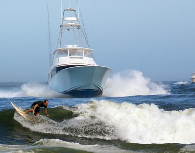 Blue sportfisher surfer in front. Now on display @ the Beach Pub