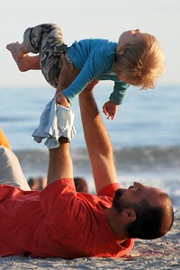 father holding his son up in the air