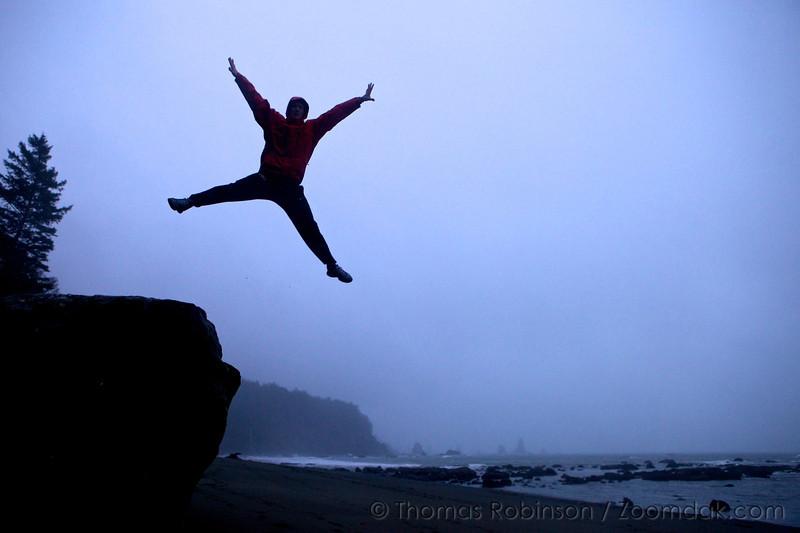 Anthony Priest leaps into the air joy above Strawberry Bay / Third Beach on the Olympic Peninsula near La Push, Washington. Pickly wysiwug!