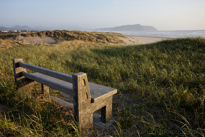 A bench invites people to sit and rest and enjoy the beautiful beach at Del Ray Beach, Gearhart.