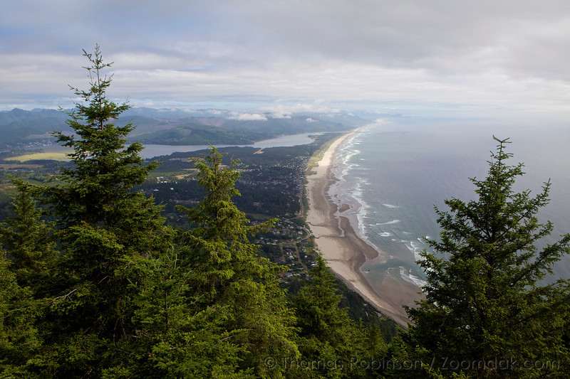 """The view from the top of Mt. Neahkahnie shows the Oregon Coastline stretching from Manzanita down to Tillamook Bay. The name Neahkahnie comes from their words Ne """"place of"""" and Ekahnie """"supreme deity""""."""