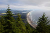 "The view from the top of Mt. Neahkahnie shows the Oregon Coastline stretching from Manzanita down to Tillamook Bay. The name Neahkahnie comes from their words Ne ""place of"" and Ekahnie ""supreme deity""."
