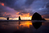 The last light of the day produces color in the clouds at sunset in Cannon Beach, Oregon.