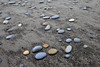 Round beach stones lay upon the sands of Ruby Beach in the Kalaloch area of the Olympic National Park. Kalaloch means a good place to land in the Quinault language.