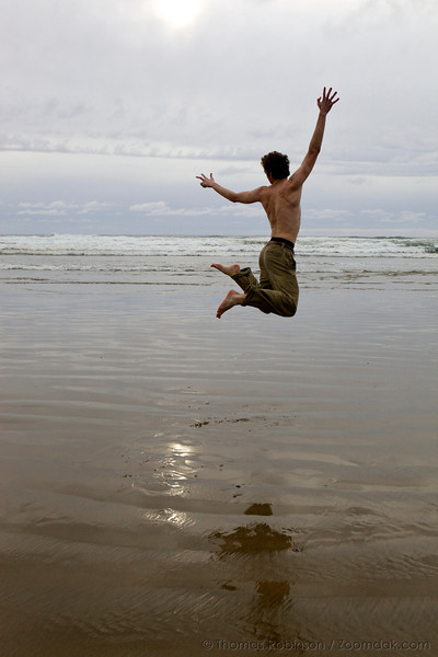 """Thomas Robinson leaps for joy and play at Arcadia Beach near Arch Cape, Oregon. <br /> <br /> Also see this image as a poster: <a href=""""http://smu.gs/zxQVRy"""">http://smu.gs/zxQVRy</a>"""