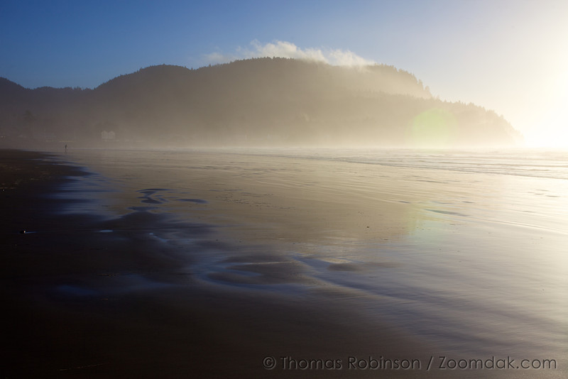 Tillamook Head glows in the mist of the afternoon light in Seaside, Oregon.