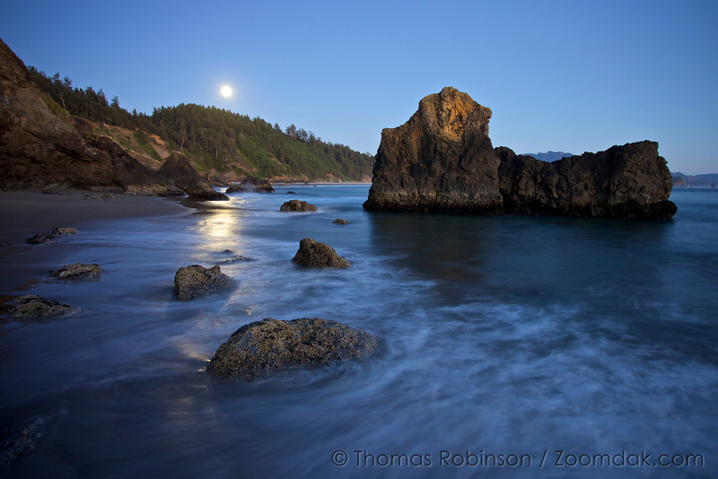Moonlight shimmers across an incoming wave at Ecola Beach in Ecola State Park.