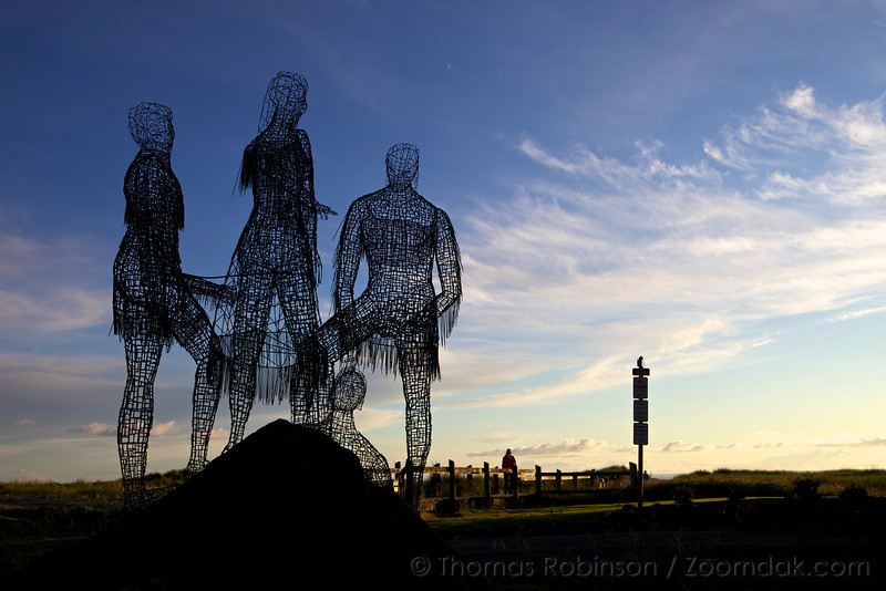 A wireframe sculpture in Cannon Beach representing Lewis and Clark and their guide, Sacagawea.