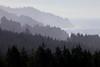 Mountain ridges stretch down to the ocean along the Oregon Coast.