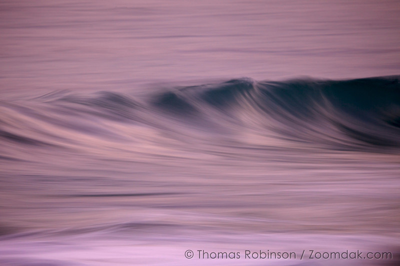 Purple Wavescape: Waves roll to shore on the Cabo coastline. The streaked effect is achieved with a long exposure to show the motion of the surf.