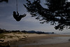 Nathaniel Orwieler flies out on a rope swing at Chapman Beach in Cannon Beach, Oregon.