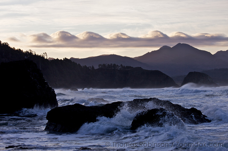 Clouds over the Oregon Coastal Range imitate the waves rolling in below Ecola Point State Park.