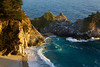 A tidefall - a waterfall that pores onto a beach - called McWay Falls tumbles 80 feet (24 meters) at sunset on the beach in Julia Pfeiffer Burns State Park, along the Big Sur coastline in California.