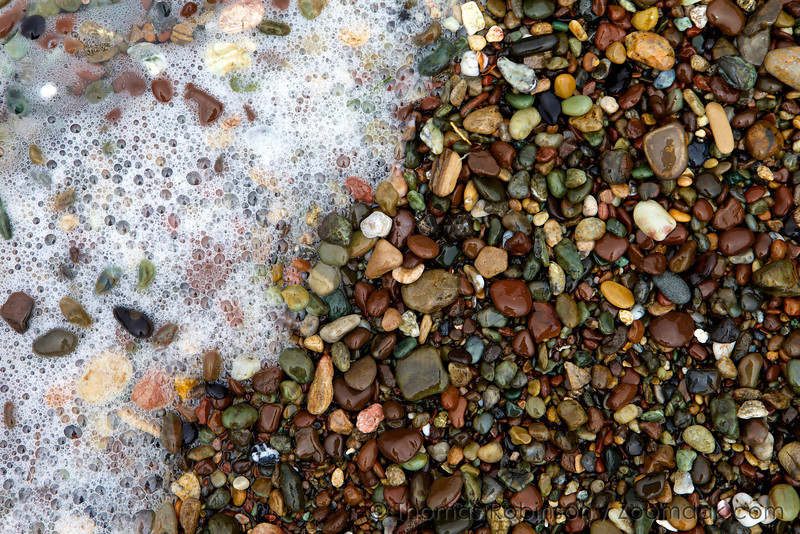 Foam washes up on the beautifully colored stones of Moonstone Beach in Cambria, California.