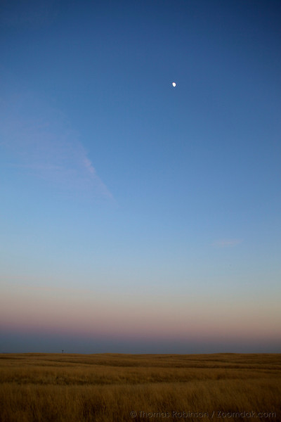 The moon climbs the sky above the earth shadow and fields near Madera, California.