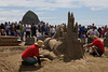 Sand Castle contestants build a sculpture of a castle being grabbed by a claw during Sand Castle Day 2010 in Cannon Beach, Oregon.