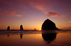 A beautiful sunset at Haystack Rock in Cannon Beach, Oregon.